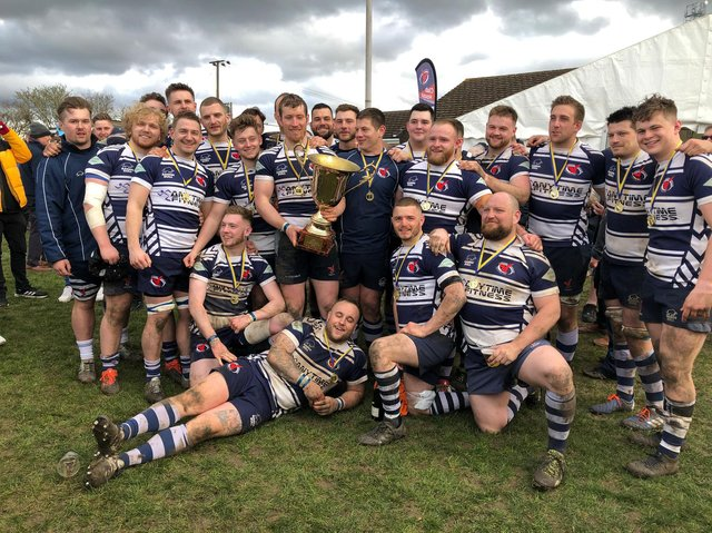 Buzzards celebrating after becoming Midlands Intermediate Cup champions earlier this month  Picture by Steve Draper