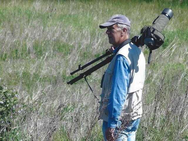 Peter Smith birdwatching at The Sandy Smith Nature Reserve. Photo: Peter Smith.