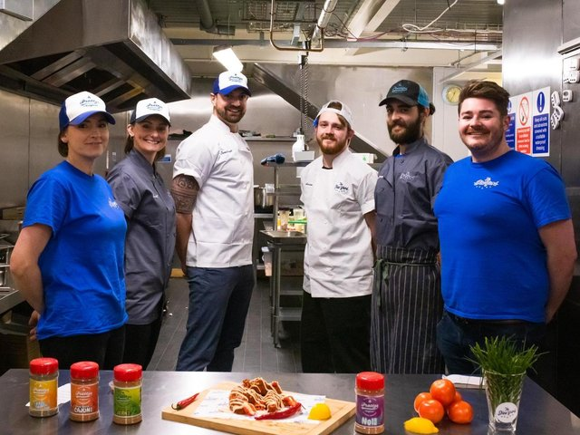 The Dine Yard team. (James pictured third from left). Credit: Freckles Creative.