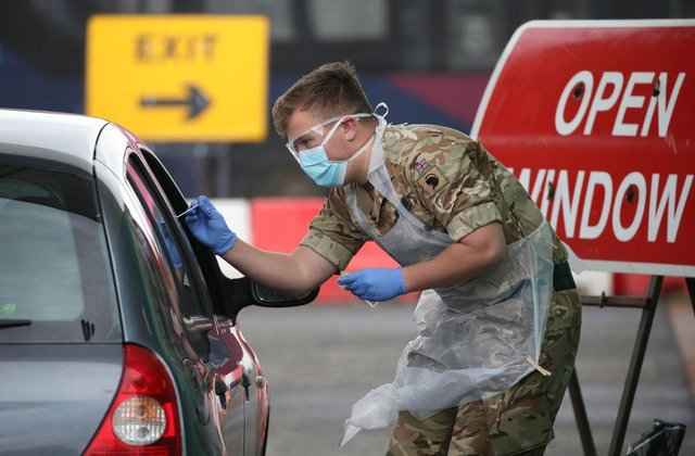 A soldier from 2nd Scots Royal Regiment of Scotland takes a test sample at a Covid-19 testing centre at Glasgow Airport (Photo: Andrew Milligan-WPA Pool/Getty Images)